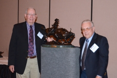 Dr. Vineyard receives the Pioneer Award from John McKnight