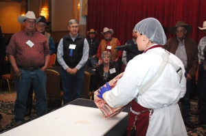 Leslie Frenzel gave a live demonstration in deboning and processing a rib roll to an engaged crowd of producers..